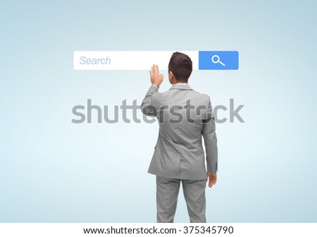 business, people, internet and technology concept - businessman touching virtual projection of browser search bar from back #375345790