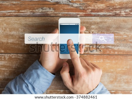 business, people, internet and technology concept - close up of male hands holding smartphone and pointing finger browser search bar #374882461