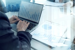 BUSINESS PEOPLE INVESTMENT Advisory TEAM ANalyzes Company's Annual FINANCIAL Statements. Balance Sheets WORK With Graph Papers. Concept Internal AUDIT TAX Return on  Investment Analysis Shareholders
