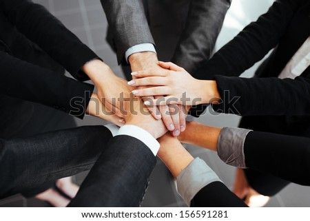 Business people joining hands. Team work concept. #156591281