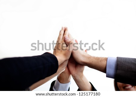 Business people joining hands together isolated.