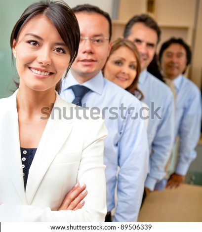Business people lead by a female at the office