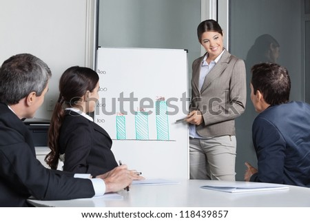 Business people listening to presentation with a whiteboard in the office - stock photo