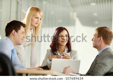 Business people looking at their male colleague as he has come up with a really good idea