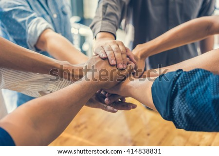 business people making pile of hands , soft focus, vintage tone