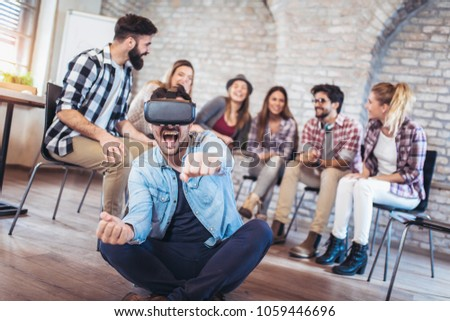 Business people making team training exercise during team building seminar using VR glasses #1059446696