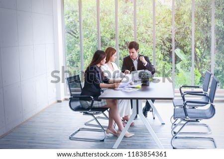 Business people meeting and sitting in office room with green trees background from window view #1183854361