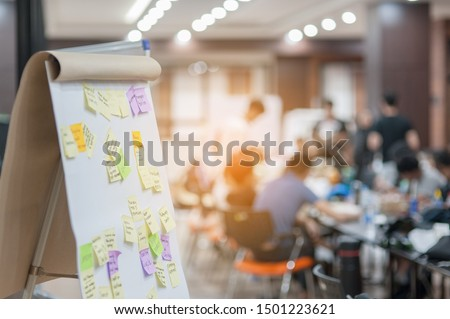 Business people meeting at office and use post it notes to share idea. Brainstorming concept