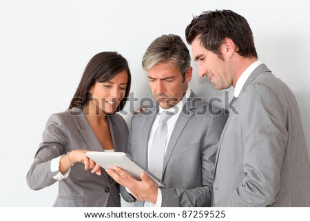 Business people meeting in hall with tablet