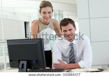 Business people meeting in office in front of desktop