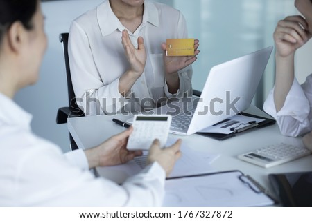 Business people meeting with credit card