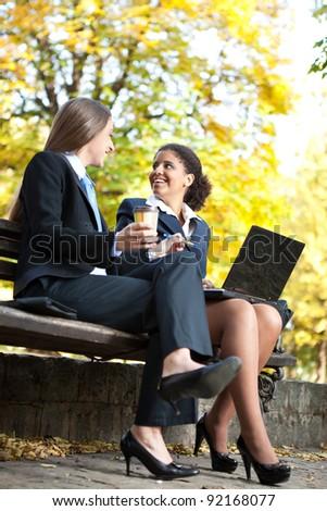 business people on coffee break talking about job