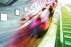 business people on Elevators in metro station