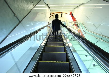 business people on escalator at metro station in United Emirate