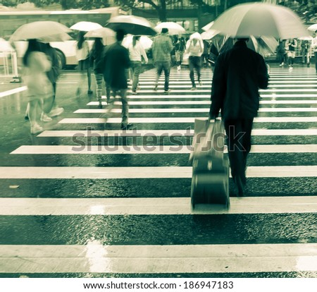 business people on zebra crossing street,blurred motion image