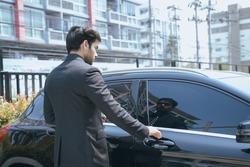 Business people open the car door,Stylish businessman opens the door of his car.