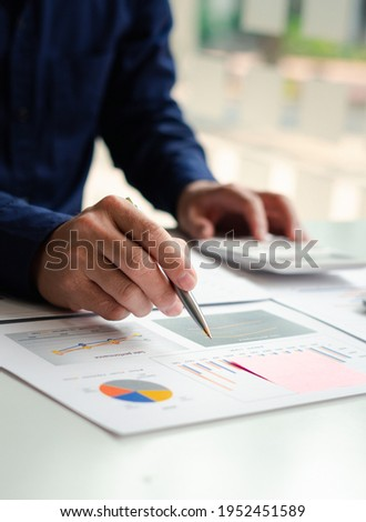 Business people or accountants are analyzing graphs on finance, investment, graph chart business strategy ideas, data analysis technology.