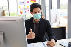 Business people or office worker are working and wear mask for protect Covid-19 or corona virus disease but business must be continuous, healthcare concept