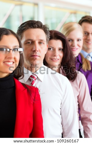 Business people or team in office looking to the viewer