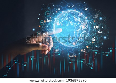 Business people point to the virtual hologram in the internet cyberspace, online business and graph the rising trend of finance, future life.
