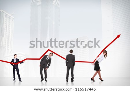 business people pushing a business graph upwards