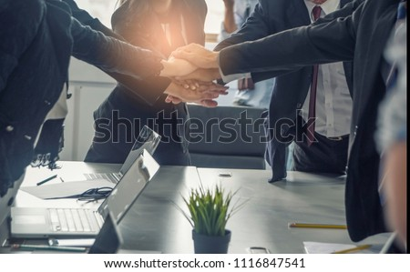Business people putting their hands together. Hand  ,Unity ,success and teamwork concept.