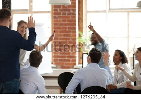 Business people raising hands up voting asking questions at corporate conference educational training, employees engaged in volunteering at group meeting, coaching, teambuilding activity concept