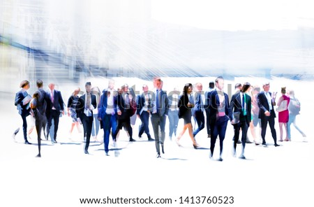 Business people rushing in the City of London against on the skyscrapers. Beautiful abstract blurred image representing modern business life, success, moving concept. #1413760523