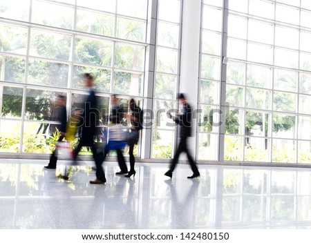 Business people rushing in the lobby. motion blur