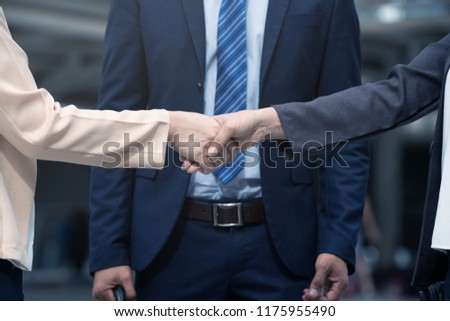 Business People Shakes Hands Showing Trustworthy Team work Business etiquette am pleased With mergers and Acquisition . Take the company to a Successful Business.