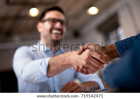 Business people shaking hands.