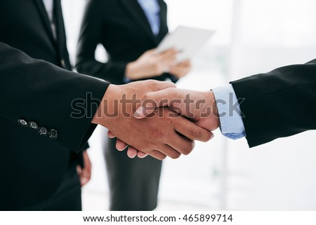 Business people shaking hands after successful deal - Shutterstock ID 465899714