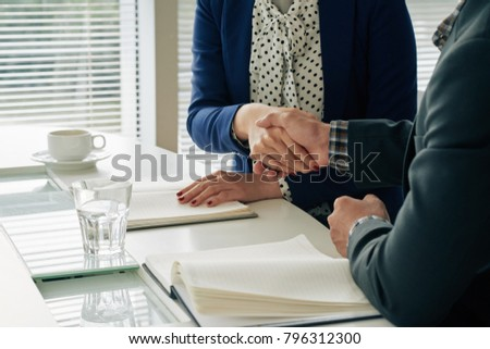Business people shaking hands after successful meeting