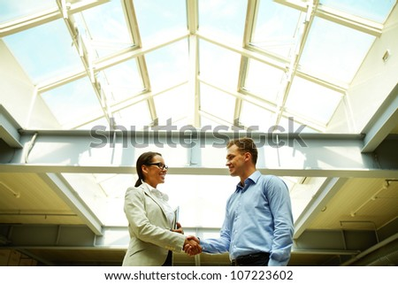 Business people shaking hands concluding a deal or greeting each other