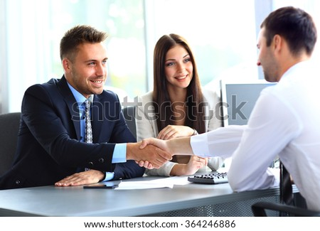 Business people shaking hands, finishing up a meeting - Shutterstock ID 364246886