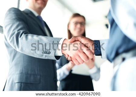 Business people shaking hands, finishing up a meeting #420967090