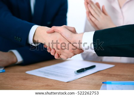 Business people shaking hands finishing up a meeting #522262753