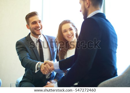 Business people shaking hands, finishing up a meeting #547272460