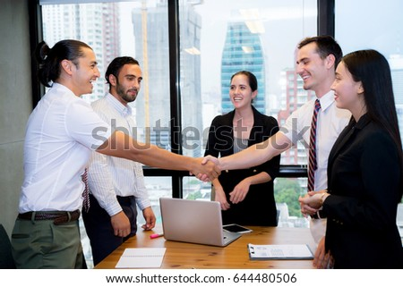 Business people shaking hands, finishing up a meeting. #644480506