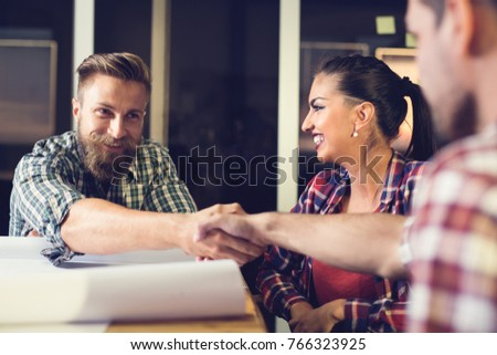 Business people shaking hands, finishing up a meeting #766323925