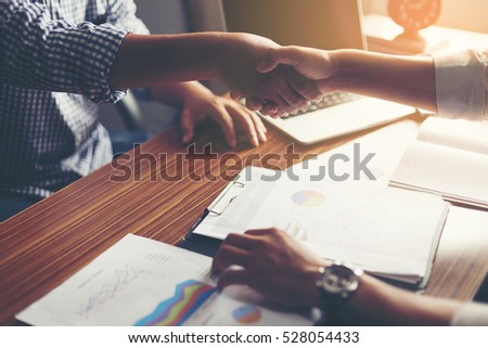 Business people shaking hands, finishing up a meeting Handshake Business concept #528054433