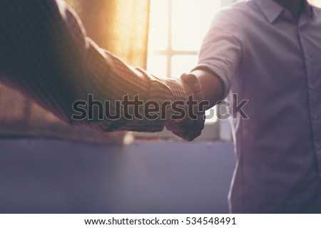 Business people shaking hands, finishing up a meeting\nHandshake Business concept