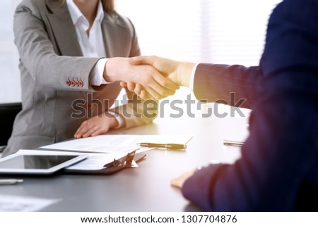 Business people shaking hands, finishing up a meeting. Papers signing, agreement and lawyer consulting concept #1307704876