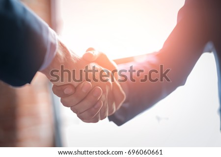 Business people shaking hands, finishing up meeting. Successful businessmen handshaking after good deal. Stock photo ©