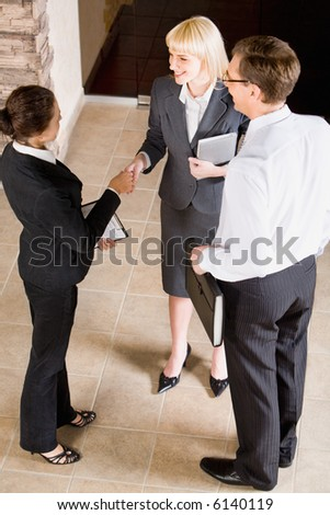 Business people shaking hands making an agreement