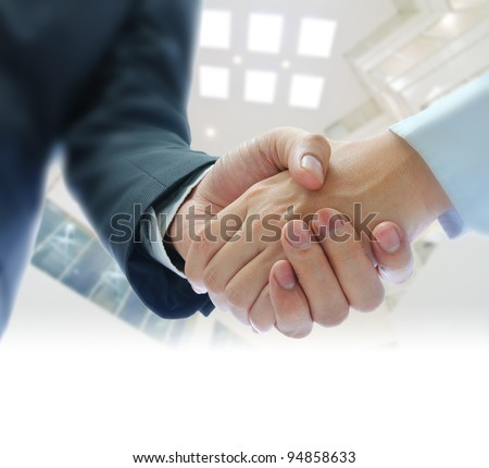 business people shaking hands  on indoor building background