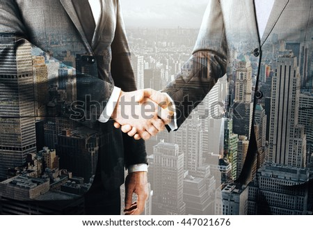Business people shaking hands on New York city background. Concept of partnership. Double exposure