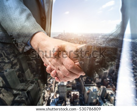 Business people shaking their hands. Double exposure effect #530786809