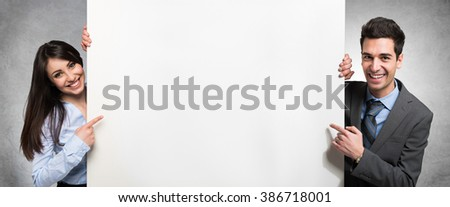 Business people showing an empty banner