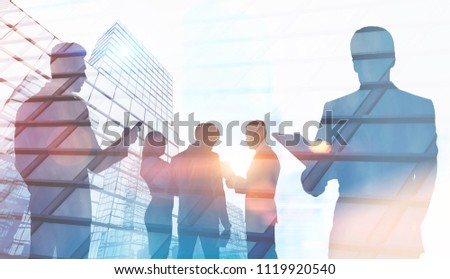 Business people silhouettes. A foggy city background. Concept of a modern company. Toned image double exposure mock up.